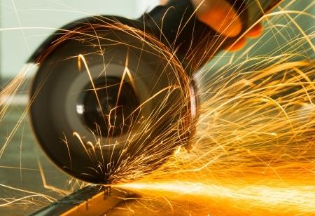 Worker Grinding Steel Material